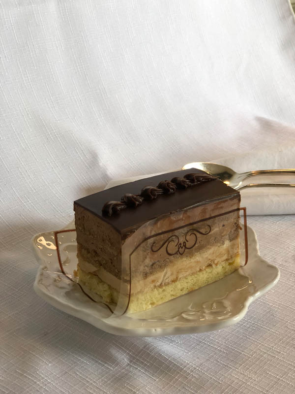 Opera ~ Almond sponge cake with coffee buttercreme and dark chocolate mousse layers, finished with Belgian chocolate ganache