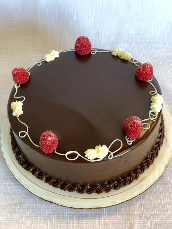 Raspberry Chocolate Ganache ~ Dark chocolate ganache and raspberry preserves between chocolate sponge cake layers