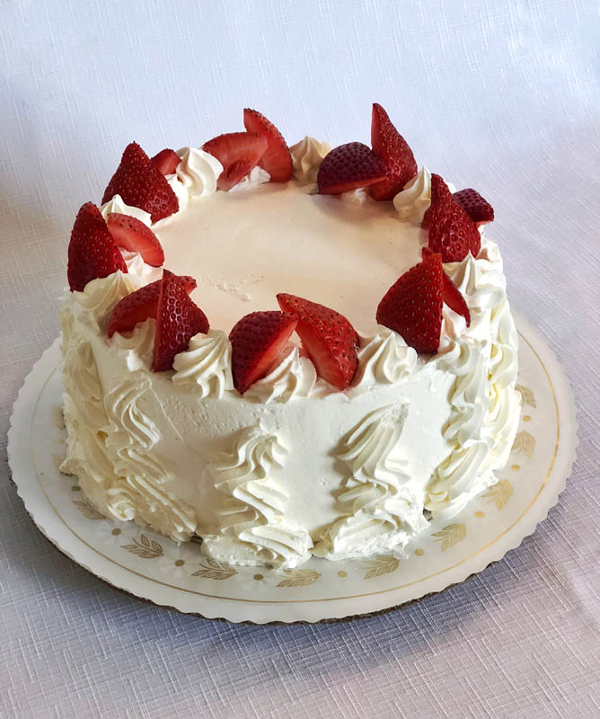 Strawberry Shortcake ~ Vanilla sponge cake layered with fresh strawberries and whipped crème